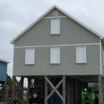 Hurricane shutters on Gulf Shores home.