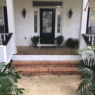 Finished post and rails on front porch