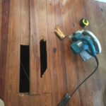 Cutting out damaged wood flooring