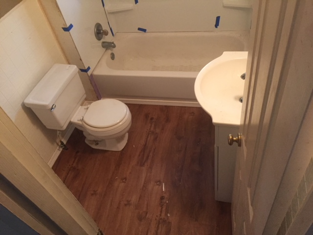 Finished bathroom with hardwood floors