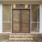 Double doors on custom screened porch