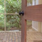 Cedar door on screened porch